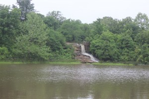 The waterfall from the fishing lake to the swimming lake is running pretty hard.