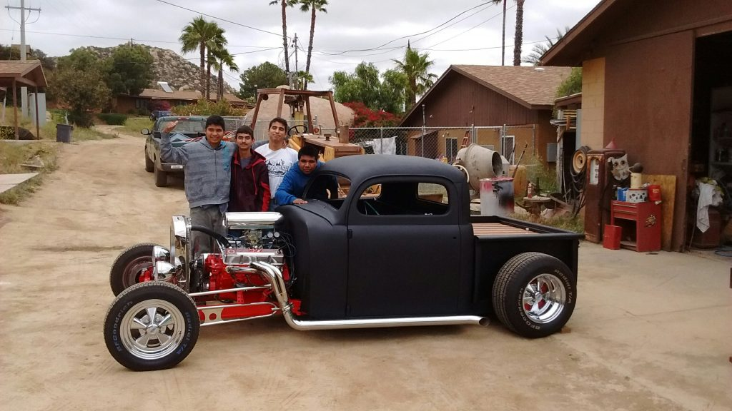 This is the finished ratrod and some of Doug's students. Left to right: Irvin, Jesus, Isaac, Eliezer